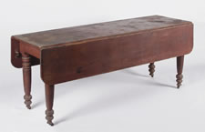 RED PAINTED AMERICAN DROPLEAF FARM TABLE ON SUBSTANTIAL, TURNED, COUNTRY SHERATON LEGS, FOUND IN THE ADIRONDACK REGION OF NEW YORK STATE, 1830-1860