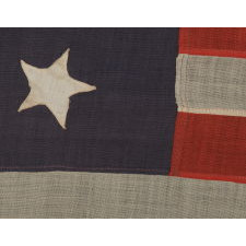13 STARS IN A 4-5-4 PATTERN ON STONE BLUE CANTON, ON A FLAG WITH BEAUTIFUL ELONGATED PROPORTIONS, MADE BETWEEN 1876 AND THE EARLY 1890's