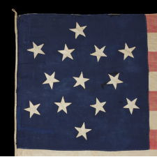 ENTIRELY HAND-SEWN 13 STAR FLAG WITH A 6-POINTED GREAT STAR / STAR OF DAVID PATTERN, ONE OF A TINY HANDFUL OF PIECED-AND-SEWN EXAMPLES WITH THIS EXTRAORDINARILY RARE STAR DESIGN, MADE DURING THE CIVIL WAR ERA (1861-65), WITH ENDEARING GRAPHICS, WEAR, AND EARLY REPAIRS: