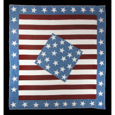 OUTSTANDING CIVIL WAR PATRIOTIC QUILT IN A DIAMOND-IN-A-SQUARE PATTERN SOURCED FROM PETERSON'S MAGAZINE, JULY 1861, MODIFIED BY THE MAKER TO INCLUDE 35 STARS AROUND THE PERIMETER AND A SOUTHERN-EXCLUSIONARY COUNT OF 20 STARS IN THE CENTER, 1863-1864