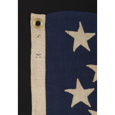 13 HAND-SEWN, SINGLE-APPLIQUÉD STARS, LIKELY MADE BY ANNIN & CO. IN NEW YORK CITY, IN A RARE, SMALL SIZE AMONG KNOWN FLAGS WITH SEWN CONSTRUCTION, 1861-1876 ERA, PROBABLY DESIGNED FOR USE AS A CAMP COLORS OR IN SOME OTHER MILITARY FUNCTION