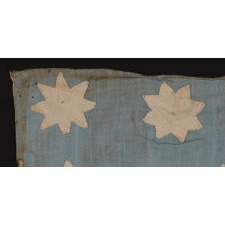 EXTRAORDINARY, HAND-SEWN, 13 STAR AMERICAN NATIONAL FLAG WITH 8-POINTED STARS ON A GLAZED COTTON, CORNFLOWER BLUE CANTON, 12 STRIPES, AND ITS CANTON RESTING ON THE WAR STRIPE, FOUND IN UPSTATE, NEW YORK, PRE-CIVIL WAR, CA 1830-1850