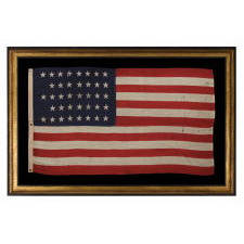 "38 STARS IN A ""NOTCHED"" PATTERN ON A CLAMP-DYED AMERICAN FLAG OF THE 1876-1889 PERIOD, REFLECTS COLORADO STATEHOOD, MADE BY THE U.S. BUNTING COMPANY IN LOWELL, MASSACHUSETTS​"