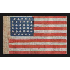 """34 STARS IN A LINEAL ARRANGEMENT THAT RESULTS IN A CONFIGURATION THAT I HAVE TERMED """"GLOBAL ROWS,"""" MADE DURING THE OPENING TWO YEARS OF THE CIVIL WAR, 1861-63, KANSAS STATEHOOD"""