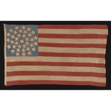 "36 STARS ARRANGED IN A RARE ""SNOWBALL MEDALLION,"" ON AN ENTIRELY HAND-SEWN FLAG OF THE CIVIL WAR ERA, WITH GREAT WEAR FROM EXTENDED USE AND IN A GREAT SMALL SIZE FOR THE PERIOD, 1864-1867, NEVADA STATEHOOD"