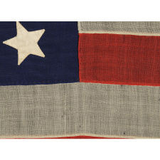 34 STARS ON AN ANTIQUE AMERICAN FLAG OF THE CIVIL WAR PERIOD, MADE BY WILLIAM G. MINTZER IN PHILADELPHIA, PENNSYLVANIA, 1861-63, REFLECTS KANSAS STATEHOOD