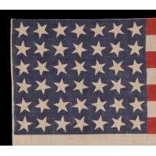 42 STARS, AN UNOFFICIAL STAR COUNT, ON AN ANTIQUE AMERICAN FLAG WITH SCATTERED STAR POSITIONING, 1889-1890, WASHINGTON STATEHOOD