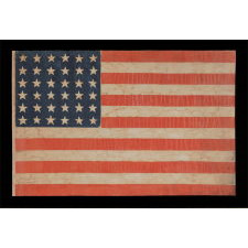 36 STAR ANTIQUE AMERICAN PARADE FLAG OF THE CIVIL WAR ERA, IN AN ESPECIALLY LARGE SCALE AND WITH BOLD COLOR, 1864-67, NEVADA STATEHOOD