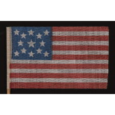 13 STARS IN A MEDALLION PATTERN ON AN ANTIQUE AMERICAN FLAG MADE FOR THE 1876 CENTENNIAL CELEBRATION
