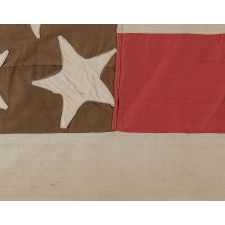 23 STARS ON AN ANTIQUE AMERICAN FLAG MADE IN THE PERIOD BETWEEN 1870 AND THE 1890'S; AN EXTREMELY RARE STAR COUNT, PROBABLY MADE TO COMMEMORATE THE YEAR IN WHICH MAINE ENTERED THE UNION AS THE 23rd STATE, IN 1820