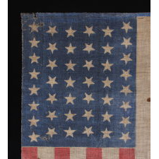 44 STARS IN DANCING ROWS IN AN HOURGLASS FORMATION, ON AN ANTIQUE AMERICAN PARADE FLAG, 1890-1896, REFLECTS WYOMING STATEHOOD