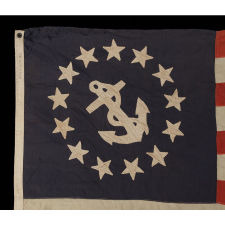 13 STAR PRIVATE YACHT FLAG, WITH HAND-SEWN, SINGLE-APPLIQUÉD STARS AND ANCHOR, MADE BY ANNIN IN NEW YORK CITY, CA 1875-1890, A GREAT, EARLY EXAMPLE AMONG SURVIVING FLAGS IN THIS FORM