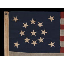 "13 STARS IN A MEDALLION CONFIGURATION ON A SMALL-SCALE ANTIQUE AMERICAN FLAG OF THE 1895-1926 ERA, SIGNED ""TAUTOG,"" PROBABLY FLOWN ON THE YACHT OF THAT NAME BY OWNER GEORGE GARDINER FRY, WHO WON MANY RACES WITH HER AT THE TURN-OF-THE-CENTURY"