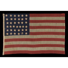 37 SINGLE APPLIQUÉD STARS ON AN ANTIQUE AMERICAN FLAG MADE DURING THE RECONSTRUCTION ERA, DURING THE INDIAN WARS, BETWEEN 1867-1876, WHEN NEBRASKA WAS THE MOST RECENT STATE TO JOIN THE UNION