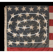 33 HAPHAZARDLY PLACED STARS AND 11 STRIPES ON AN ANTIQUE AMERICAN FLAG WITH ITS CANTON RESTING ON THE WAR STRIPE, MADE IN THE PERIOD BETWEEN 1859-1861, OREGON STATEHOOD, PRE-CIVIL WAR THROUGH THE WAR'S OPENING YEAR