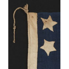 34 STARS, IN A CONFIGURATION THAT IS UNIQUE TO THIS SMALL SCALE, CIVIL WAR FLAG, WITH SUBSTANTIAL FOLK ART QUALITIES, 1861-63, KANSAS STATEHOOD