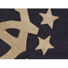 13 STAR PRIVATE YACHT ENSIGN, THE SMALLEST EXAMPLE THAT I HAVE EVER ENCOUNTERED WITH HAND-SEWN STARS AND A CANTED ANCHOR, 1885-1895