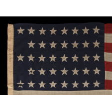 "38 STARS IN A ""NOTCHED"" PATTERN ON A 5 ft. CLAMP-DYED AMERICAN FLAG OF THE 1876-1889 PERIOD, REFLECTS COLORADO STATEHOOD, MADE BY THE U.S. BUNTING COMPANY IN LOWELL, MASSACHUSETTS"