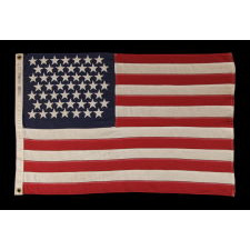 49 STARS ON A SMALL SCALE PIECED-AND-SEWN AMERICAN FLAG REFLECTING THE ADDITION OF ALASKA IN 1959, OFFICIAL FOR JUST ONE YEAR, MADE BY DETTRA IN OAKS, PENNSYLVANIA