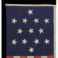 ENTIRELY HAND-SEWN 13 STAR FLAG WITH A 6-POINTED GREAT STAR / STAR OF DAVID PATTERN, ONE OF A TINY HANDFUL OF PIECED-AND-SEWN EXAMPLES WITH THIS EXTRAORDINARILY RARE STAR DESIGN, MADE DURING THE CIVIL WAR ERA