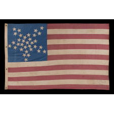 "33 STARS IN A ""GREAT STAR"" OR ""GREAT LUMINARY"" PATTERN ON A HOMEMADE FLAG WITH A BEAUTIFUL, GLAZED COTTON CANTON, 1859-61, PRE-CIVIL WAR THROUGH WAR PERIOD, OREGON STATEHOOD"