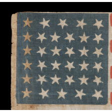 34 STARS, WITH SCATTERED POSITIONING, ON AN ANTIQUE AMERICAN PARADE FLAG MADE DURING THE OPENING TWO YEARS OF THE CIVIL WAR, 1861-63, KANSAS STATEHOOD