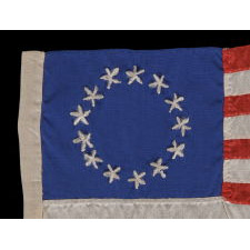 13 HAND-EMBROIDERED STARS AND EXPERTLY HAND-SEWN STRIPES ON AN ANTIQUE AMERICAN FLAG MADE IN PHILADELPHIA IN BY RACHEL ALBRIGHT OR SARAH M. WILSON, GRANDDAUGHTER AND GREAT GRANDDAUGHTER OF BETSY ROSS, 1898-1913