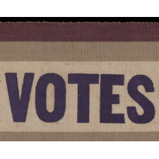 "SILK SUFFRAGETTE SASH RIBBON IN VIOLET & GREEN WITH ""VOTES FOR WOMEN"" TEXT, MADE FOR THE WOMEN'S POLITICAL UNION IN NEW YORK CITY, 1910-1915"