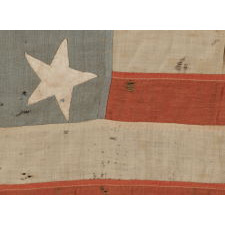 13 STARS IN A 4-5-4 PATTERN, ON A FLAG OF THE CIVIL WAR ERA, WITH BEAUTIFUL COLORATION AND IN A TINY SCALE AMONGST ITS PIECED-AND-SEWN COUNTERPARTS