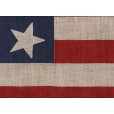 13 STAR PARADE FLAG IN A 3-2-3-2-3 PATTERN, MADE CA 1876-1898, UNUSUALLY LARGE AND WITH AN UNUSUAL STAR PATTERN AMONG ITS COUNTERPARTS OF THE 19TH CENTURY