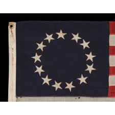 13 STARS IN THE BETSY ROSS PATTERN ON A SMALL-SCALE ANTIQUE AMERICAN FLAG OF THE 1895-1920's ERA