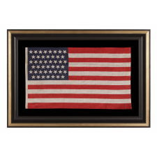 "45 STARS IN LINEAR ROWS, WITH ""DANCING"" OR ""TUMBLING"" ORIENTATION, ON AN ANTIQUE AMERICAN PARADE FLAG, 1896-1908, SPANISH-AMERICAN WAR ERA, REFLECTS UTAH STATEHOOD"