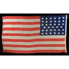 35 SINGLE-APPLIQUÉD STARS ON A CIVIL WAR PERIOD FLAG, SIGNED BY A SURGEON FROM SARATOGA SPRINGS, NEW YORK WHO SERVED WITH THE 29TH NEW YORK STATE MILITIA, WHICH MUSTERED OUT ON JUNE 20TH, 1863, THE EXACT DAY UPON WHICH WEST VIRGINIA BECAME THE 35TH STATE; OFFICIAL FROM THAT YEAR UNTIL 1865