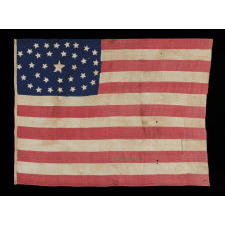34 STARS IN AN OUTSTANDING OVAL MEDALLION CONFIGURATION, ON A NARROW CANTON THAT RESTS ON THE 6TH STRIPE, A HOMEMADE, ANTIQUE AMERICAN FLAG OF THE CIVIL WAR PERIOD, ENTIRELY HAND-SEWN, 1861-63, KANSAS STATEHOOD