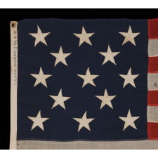 "13 STARS ARRANGED IN A 3-2-3-2-3 PATTERN ON A SMALL-SCALE ANTIQUE AMERICAN FLAG MARKED ""UNITED STATES ARMY STANDARD BUNTING"", CA 1895 - 1910"