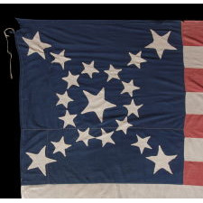 19 STARS IN AN SPECTACULAR STARBURST MEDALLION UNIQUE TO THIS FLAG, MADE SOMETIME BETWEEN THE CIVIL WAR (1861-65) AND THE OPENING OF THE 1890'S, EITHER TO REFLECT NORTHERN SYMPATHIES, BY REPRESENTING THE COMPLIMENT OF UNION-SUPPORTING STATES AT THE TIME, OR TO COMMEMORATE INDIANA AS THE 19TH STATE TO JOIN THE UNION