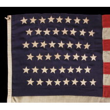 48 STARS IN STAGGERED ROWS ON AN ANTIQUE AMERICAN FLAG MADE BETWEEN 1912 AND 1918, OR PERHAPS PRIOR; REFLECTS ARIZONA & NEW MEXICO STATEHOOD