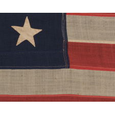 13 HAND-SEWN STARS IN A 3-2-3-2-3 PATTERN ON A U.S. NAVY SMALL BOAT ENSIGN OF THE CENTENNIAL ERA, ca 1870-1882