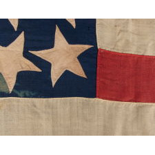 29 STARS IN A SPECTACULAR, RECTANGULAR MEDALLION WITH 4 STARS INSIDE THE PERIMETER AND A HUGE CENTER STAR ON AN OPEN BLUE EXPANSE; AMONG THE RAREST OF ALL KNOWN STAR COUNTS ON PIECED-AND-SEWN EXAMPLES, IOWA STATEHOOD, 1846-48, MEXICAN WAR PERIOD