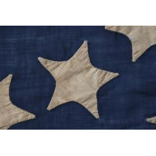 34 STARS ARRANGED IN A BEAUTIFUL RENDITION OF THE MEDALLION CONFIGURATION WITH OFFSET WREATHS AND A LARGE CENTER STAR, MADE DURING THE OPENING YEARS OF THE CIVIL WAR, 1861-1863, AND ENTIRELY HAND-SEWN, REFLECTS KANSAS STATEHOOD