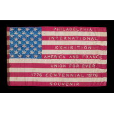 EXTRAORDINARY SILK FLAG MADE FOR THE 1876 CENTENNIAL INTERNATIONAL EXPOSITION IN PHILADELPHIA, WITH WOVEN TEXT ON EITHER SIDE, PROBABLY MADE AT ONE OF THE FRENCH EXHIBITS AT THE FAIR AND SOLD AS A SOUVENIR