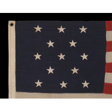 13 STARS ARRANGED IN A 3-2-3-2-3 PATTERN, ON A SMALL-SCALE ANTIQUE AMERICAN FLAG OF THE 1895-1926 ERA