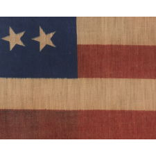 34 STARS, CIVIL WAR PERIOD, PRINTED ON A WOOL BLENDED FABRIC, RARE NOTCHED DESIGN WITH TILTED STARS, POSSIBLY A UNION ARMY CAMP COLORS