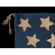 34 STAR, HAND-SEWN, HOMEMADE, ANTIQUE AMERICAN FLAG OF THE CIVIL WAR PERIOD, MADE OF A COMBINATION OF SALVAGED FABRICS, INCLUDING MENS' SHIRTING, 1861-1863, OPENING YEARS OF THE WAR, REFLECTS THE ADDITION OF KANSAS