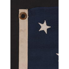 13 STARS IN A MEDALLION CONFIGURATION ON A SMALL-SCALE ANTIQUE AMERICAN FLAG OF THE 1890-1900 ERA