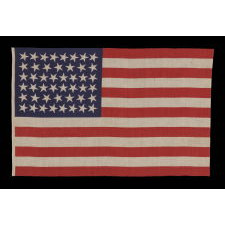 46 STARS WITH VARIED STAR POSITIONING ON AN ANTIQUE AMERICAN FLAG, 1907-1912, REFLECTS OKLAHOMA STATEHOOD